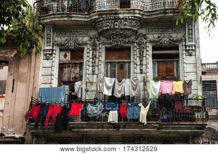 Havana, Cuba - July, 11, 2006. : Balcony in downtown Havana, traditional way of drying clothes still works in Cuba.