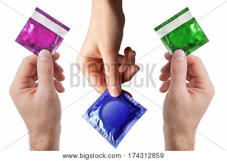 set of colored condom in female and man's hands isolated on a white background