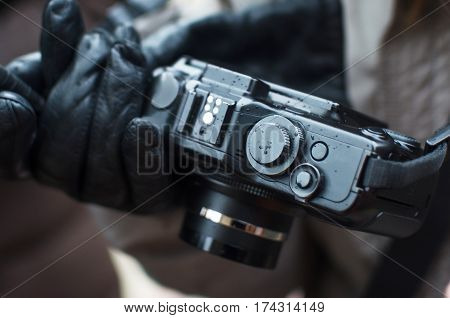 compact camera on the street in the hands with raindrops