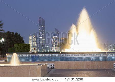 Fountain illuminated at night at the corniche in Abu Dhabi United Arab Emirates