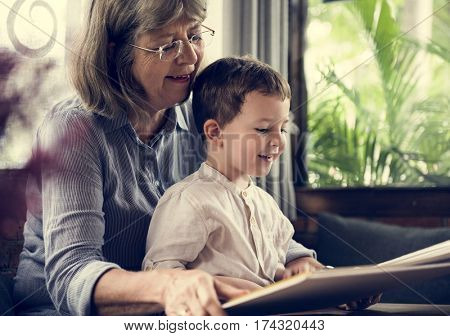 Grandmother Grandson Family Reading Book