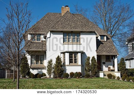 White Stucco Home with Hip Roof