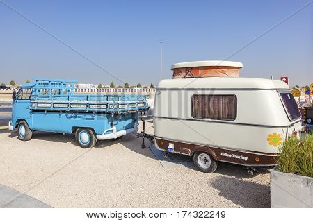 DUBAI UAE - NOV 27 2016: Historic Volkswagen T1 with an old Eriba-Touring caravan at the Last Exit food trucks park in Dubai United Arab Emirates