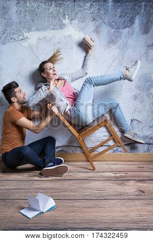 Terrified Woman On Toppling Chair