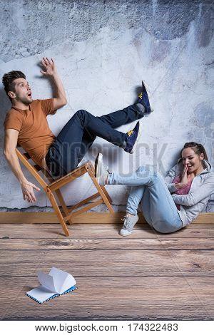 Woman Kicking Toppling Chair