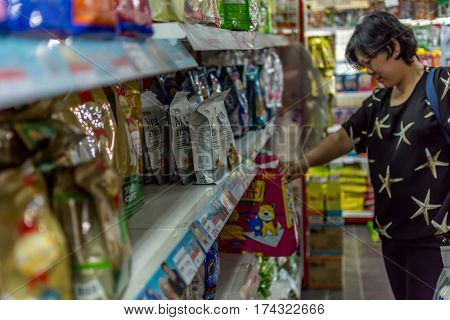 Women Shop At Pet Shop For Her Dog
