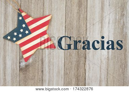 Spanish patriotic thank you message USA patriotic old flag on a star with weathered wood background with text Gracias