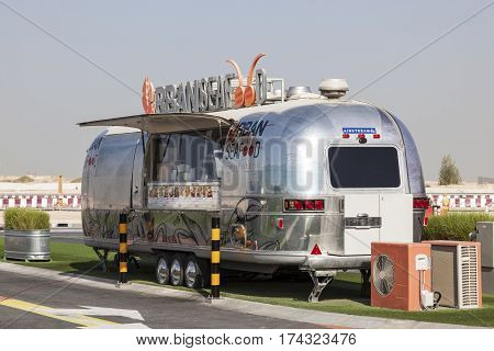 DUBAI UAE - NOV 27 2016: Airstream caravan converted to the Urgan Seafood truck at the Last Exit food trucks park on the E11 highway between Abu Dhabi and Dubai
