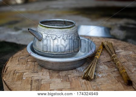 Traditional old aluminum kettle and incense for ceremonies in the temple. Indonesia Bali