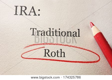 Traditional and Roth IRA circled in red pencil -- retirement concept
