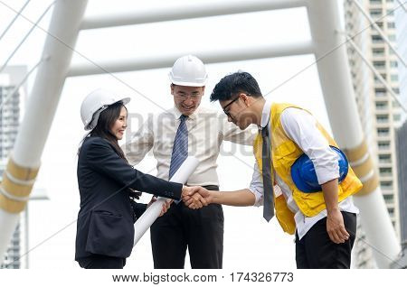 Business handshake. Architects handshake and business people concept. Partnership Deal.