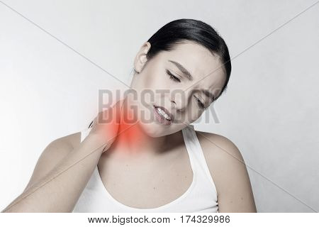 health people Sport and lifestyle concept - Tired Neck. Beautiful Young Woman Suffering From Neck Pain. Attractive Female Feeling Tired Exhausted Stressed. Girl Massaging Painful Neck With Hand.
