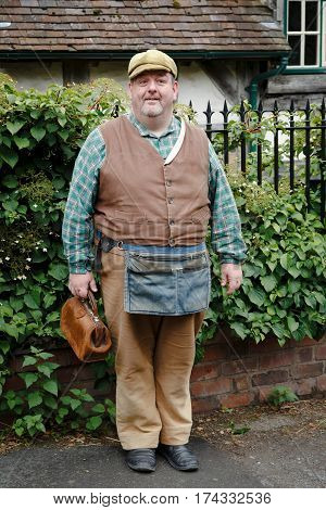 IRONBRIDGE UK - CIRCA 2013: Tradesman in traditional costume at Blists Hill Victorian Museum. Ironbridge Shropshire UK