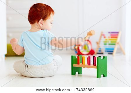 Cute Infant Baby Playing With Wooden Hammer Block Toy