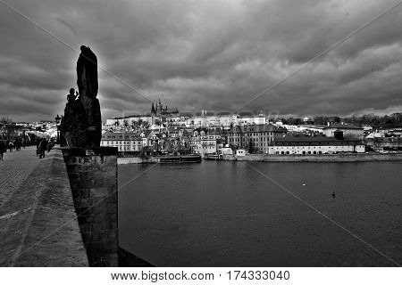 Prague Czech Republic-March 1 2017: View of Prague Castle from the embankment at the Charles Bridge in Prague in black and white