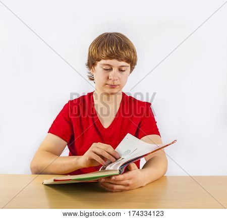 cute pupil reading in a school book