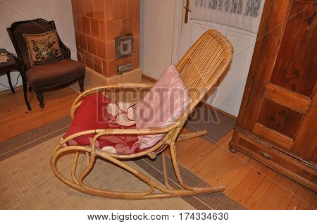 Wooden rocking chair in rural retro simple vintage interior