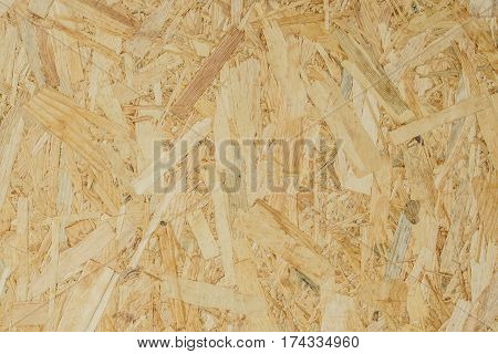 abstract background texture of Wood chips felted brown color (OSB)