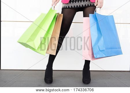 young beautiful chinese woman with colorful shopping bags
