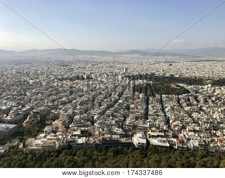 ATHENS - FEBRUARY 28, 2017: View to the North-West over the urban city sprawl from atop Mount Lycabettus in Athens, Greece.