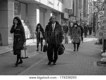 People Walking On Street In Tokyo, Japan