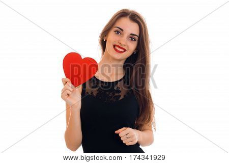 beautiful young girl in black dress holding a postcard sweetheart stands up straight and looking at camera isolated on white background