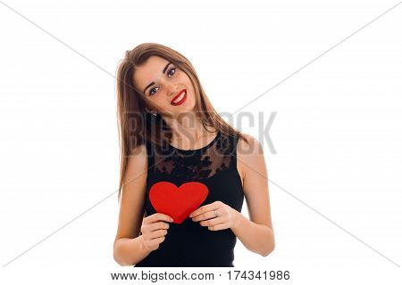 beautiful young girl cocked her head in black dress smiles and keeps a postcard sweetheart isolated on white background