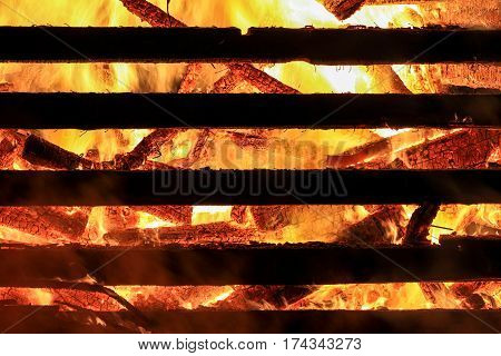 Logs in fire. Big huge traditional fire blaze glow. Background wallpaper.