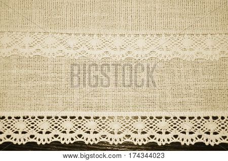 Vintage lacy lace ribbon textile sepia background texture