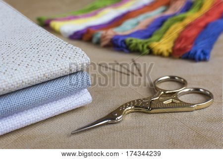 Close-up of the embroidery and cross-stitch kit. Focus on the scissors.
