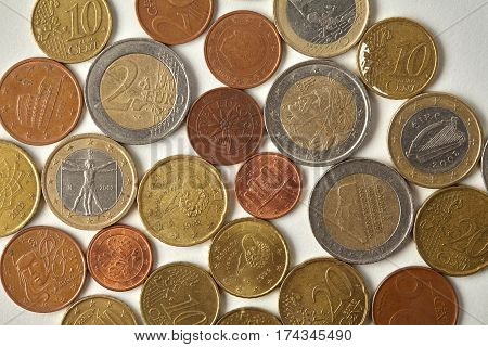 Euro cent coins macro view. Aged money Espana Spain currency closeup, textured engraving etching on paper background. Top view photo.