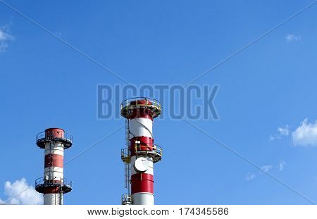 Image of a power station chimneys over blue sky
