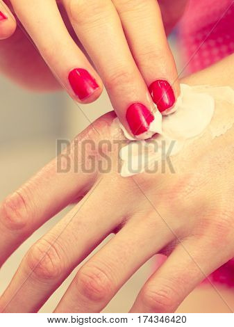 Woman Applying Hand Cream On Hands