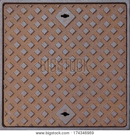 Image of a old squared rusty manhole
