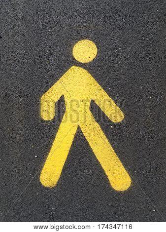 Painted sign on asphalt for pedestrian lane