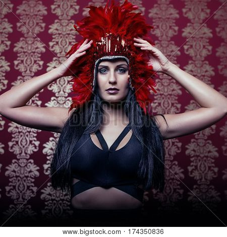 dark attractive girl with red carnival mask