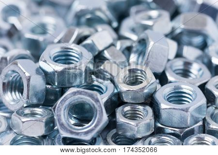 Pile Of Metal Grey Nuts In Macro Close Up Image