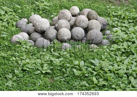 stack of old colonial rusty cannon balls in a castle
