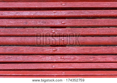 image of a red wooden bench close-up