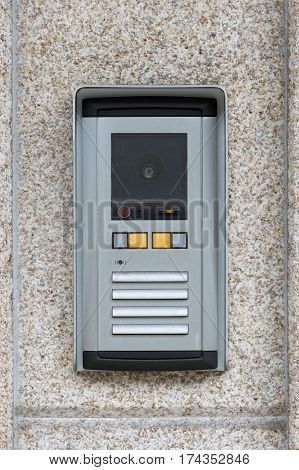intercom on the background of a granite wall