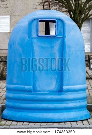 image of a blue street garbage container close-up