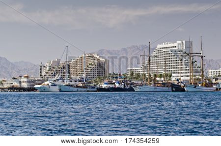 Sunny day at central public beach and marina in Eilat - famous resort city in Israel