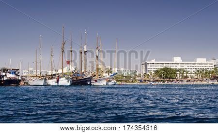 Sunny day at central public beach and marina in Eilat - number one resort and recreational city in Israel located on the Red Sea