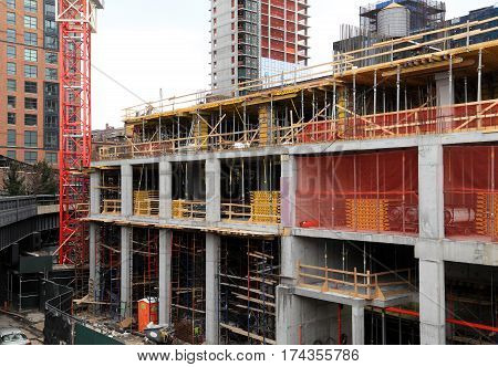 The construction site of a new building in the process of being built.