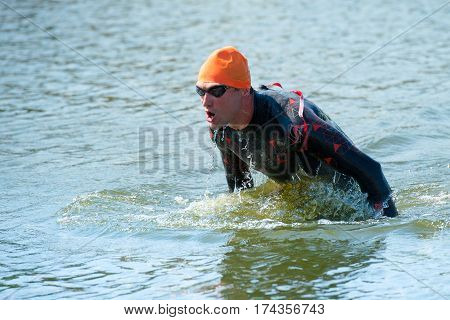 Triathlon Cup of Ukraine and Cup of Bila Tserkva. July 24 2016 in Bila Tserkva. A triathlete is running out of the water
