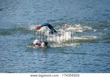 Triathlon Cup of Ukraine and Cup of Bila Tserkva. July 24 2016 in Bila Tserkva. Triathlon swimmers churning up the water.