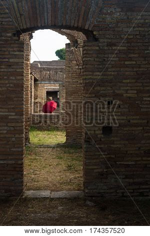Roman Arches With Red Umbrella Ostia Antica Italy