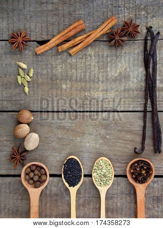 Composition Of Spices On Wooden Background: Allspice, Cloves, Fennel, Star Anise, Vanilla, Cinnamon,