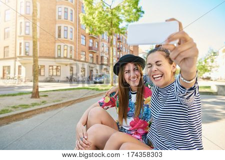 Candid Image Of A Laughing Woman Taking A Selfie