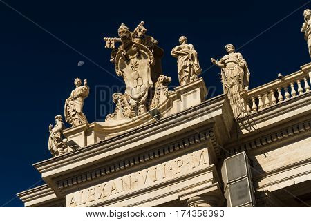Carvings On Top Of Colonnades, St Peters Square, With Moon.